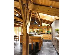 Beautiful kitchen, stone tile contrasts well with woodtones.