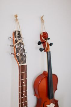 hang instruments with hemp or twine. I'm going to have to do this with my guitar and violin. hang instruments with hemp or twine. I'm going to have to do this with my guitar and violin. Guitar Storage, Guitar Display, Hang Guitar On Wall, Ukulele Wall Mount, Music Instruments Diy, Guitar Hanger, Diy Wall Art, Wall Hanger, Decoration