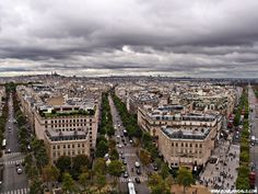 Love the symmetry of this photo from the top of the Arc de Triomphe http://www.fourjandals.com/france/paris-city-sights-photo-essay/