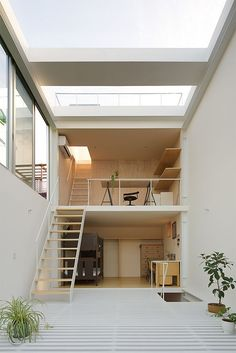 A small family house on more levels, and the light falls down from a  crystal sky. ARCHITECTURE