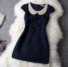 THIS DRESS!!!!!!!!!! Navy blue brocade with a pearl peter pan collar and cap sleeves. Must have! Size large!