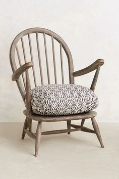 Cushioned Woodwork Chair. I like the big seat cushion. Could be a diy with a thrift store chair?