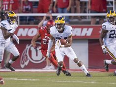 Michigan safety Jeremy Clark runs with the ball after