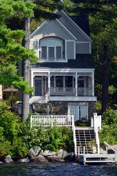 The exterior of the home is designed to complement the surrounding architecture in Blodgett Landing in Newbury, NH. Via Bonin Architects & Assoc. & Houzz