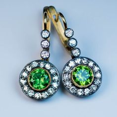 Rare Russian Demantoid and Diamond Drop Earrings by RomanovRussiacom on Etsy https://www.etsy.com/uk/listing/468934472/rare-russian-demantoid-and-diamond-drop