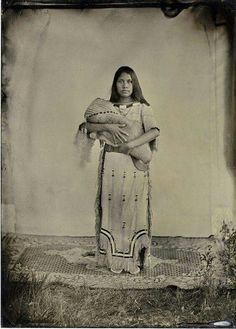 Native American woman with baby.
