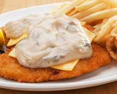 Schnitzels and seafood dishes are served with Spur-style crispy onion rings and chips OR baked potato. Replace your chips with a garden salad for a healthier alternative. Creamy Mushroom Sauce, Crispy Onions, Melted Cheese, Onion Rings, Seafood Dishes, Healthy Alternatives, Baked Potato, Stuffed Mushrooms, Breast