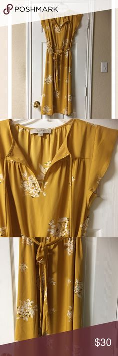 """Ann Taylor Loft Mustard Yellow & White Midi Dress Gorgeous! Ann Taylor Loft Mustard Yellow & White Midi Dress. Great condition! Soft and flowy polyester. Such a dreamy dress. Elastic waist with matching belt sash. Flutter cap sleeves. Neckline has a delicate tie. Floral print. Bust 36"""", waist 28""""-38"""", length 44"""". Wear it with grey cardigan, tights and ankle boots now. Cute wedges in the spring/summer. Ann Taylor Loft Dresses Midi"""