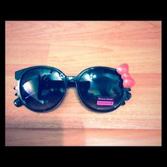 Hello Kitty Fun shades (black) Meooooowwww!!! How cute is this! ...if you know me..you will know I love kitties!! And Hello kitties! Fun hello Kitty shades in black with red bow. Available in pink, green, yellow white and turtoise ...bundle discounts: 2 for $18 Accessories
