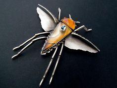 "Jim Dunakin--Bug Pin - Sterling Silver, Carnelian, Citrus Chalcedony, Blue Topaz on Montana Agate. 4""w x 4""h"