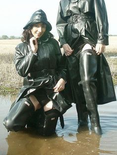 Girls in the water wearing raincoats and waders showing their panties
