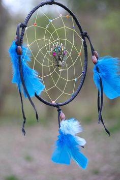 """Pretty as a Peacock Dream Catcher by raventalker on Etsy,    The Peacock has many legends surrounding its beautiful plumage. Greek mythology tells of Hera   giving the peacock its many """"eyes"""" while Chinese myths says that the blending of the five colors of its feathers is the sweet harmony of sound.     Those who have a Peacock as a totem can receive insight into their past lives and their karmic connection to their current life."""