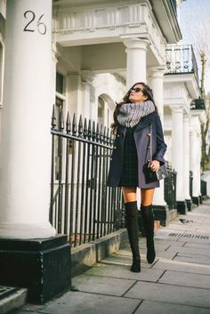 Shop this look on Lookastic:  http://lookastic.com/women/looks/sunglasses-scarf-coat-shift-dress-crossbody-bag-over-the-knee-boots/8375  — Black Sunglasses  — Grey Knit Scarf  — Black Coat  — Dark Green Plaid Shift Dress  — Black Leather Crossbody Bag  — Black Suede Over The Knee Boots