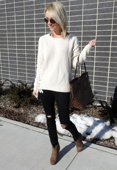 Cream knit lace up sweater, distressed black jeans and booties for fall and winter
