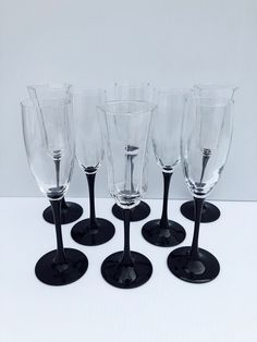 Excited to share this item from my #etsy shop: Vintage, Black Stem, Luminarc France, Champagne Flutes, Set of 9 Includes 6 Smooth Glass, Flutes and 3 Octagon, Paneled Flutes, Pristine #clear #halloween #black #glass #luminarcfluteset #luminarcblackstem #blackstemware #collectibleluminarc #weddinggift Champagne Flutes, Chip And Dip Bowl, Vintage Cowgirl, Vintage Black, Wine Glass, Classic Elegance, Black Glass, Smooth, Wooden Signs