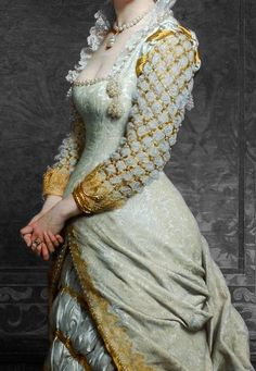I like the square neck and the upright collar. pale green brocade gown