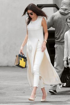 "Kendall Jenner ""Pioneers"" Wearing a Dress Over Pants Moda Indiana, Dress Over Pants, Mode Ootd, Kurti Designs Party Wear, All White Outfit, White Outfits, Kendall Jenner Outfits, Kylie Jenner, Indian Designer Wear"