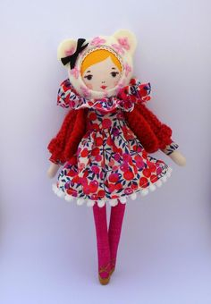 Stuffed doll with ballerina shoes and bear hood.   This link leads to a French language blog/shop.