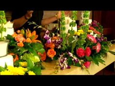 okay, this is pretty darn innovative.  Create Large Floral Arrangements with Stackables - YouTube