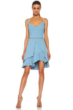 Preen by Thornton Bregazzi   Preen Colton Viscose-Blend Dress in Pale Blue -   Adjustable shoulder straps Cut out detail on front and back Fabric overlay along bottom Back zip closure Uneven flounce hem