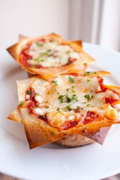 Mini lasagnas made with won ton wrappers in a muffin tin.