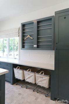 Cabinetry paint color is Benjamin Moore Knoxville Gray