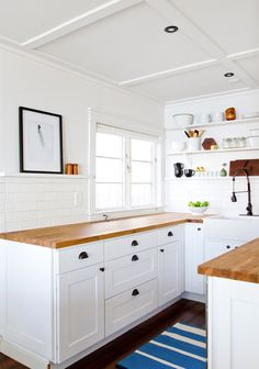Kitchen and Ceiling are just what I want (cupboards, pulls, counters, subway tile, open shelf, ledge, everything)