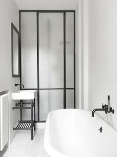 French Bathroom in Paris, France by Nicolas Schuybroek architects French minimalist chic