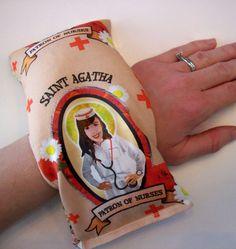 patron saint of nursing heating pad filled with jasmine rice, $14 on etsy