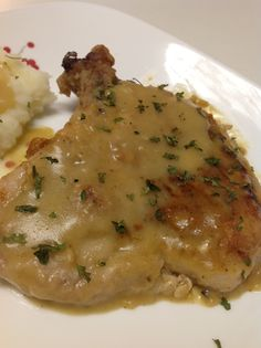 Smothered Pork Chops 1 cup all-purpose flour 2 tablespoons onion powder 2 tablespoons garlic powder 1 teaspoon cayenne 1 teaspoon salt 1/2 teaspoon freshly ground black pepper 4 pork chops, 3/4-inch thick, bone-in 1/4 cup olive oil 1 cup chicken broth 1/2 cup buttermilk Chopped fresh flat-leaf parsley, for garnish