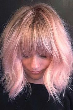 Layered haircuts with bangs look beautiful and trendy and are definitely worth trying. They are designed particularly for the women who love wearing bangs.
