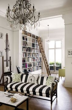 You can never have enough living room storage. Here's a clever living room storage idea for your home. White Modern Living Room with Library and Striped sofa. Glamour Décor, Modern White Living Room, Modern Wall, Living Room Decor, Living Spaces, Dining Room, Striped Sofa, Georgian Interiors, Piece A Vivre
