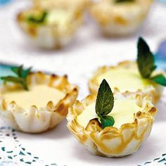 Citrus tartlets//I did these for our Derby party today, with a couple changes.  I had premade shortbread tartlets, and I used vanilla extract instead of almond.  I only did the lemon curd ones, and I garnished with mint and a single blueberry.  So EASY, and sooooo yummy, especially chilled!