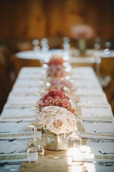 Long low row of centerpieces | On SMP: http://www.stylemepretty.com/2012/11/16/vermont-barn-wedding-from-trenholm-photo | Trent Photo