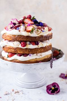 """COCONUT Eton Mess Cake- a deliciously easy, can't go wrong cake. Doubles as a beautiful centerpiece or a fun """"welcome to spring"""" cake. @halfbakedharvest.com"""