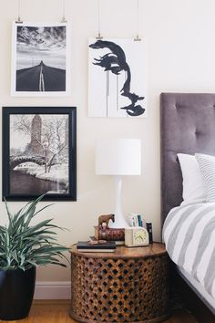 Fun side table and skinny neck lamp in this Eclectic Bedroom by Nanette Wong