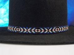 """""""Eye of the Medicine Man Hat Band"""" Native American Beaded Hat Band In The Eye of the Medicine Man pattern with the shades of blue, black, red, cream and white by LJ Greywolf The meaning of the Eye of"""