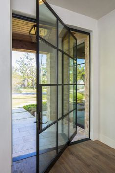 Portella Steel Doors and Windows can provide custom windows and doors to complete any project. Check out our steel and iron pivot doors! & Thompson Custom Homes - Designs by Robert Dame - Houston TX ...