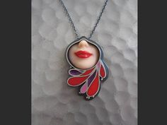 Margaux Lange Plastic Body Series - jewelry formed from Barbie dolls!   http://www.margauxlange.com/portfolio/production/necklaces/
