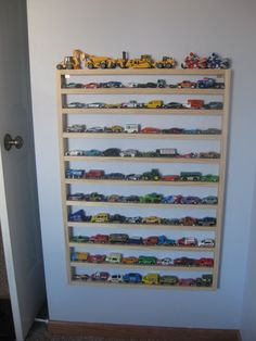 Super simple and inexpensive display frame for small toys. A few 1x2s and some nails :)