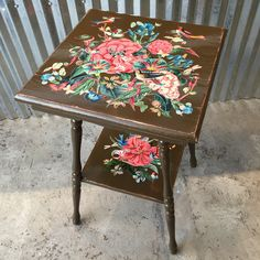"""""""Hummingbird Heaven"""" chalk-painted and hand cut decoupaged two tier table crafted by Terri Yellalonis exclusively at MTFF."""