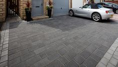Create an impact with this larger sized Drivesys block paving featuring a flamed effect finish. See the full Drivesys range online. Driveway Paving Stones, Block Paving Driveway, Concrete Driveways, Driveway Landscaping, Driveway Gate, Front Garden Ideas Driveway, Garden Front Of House, Driveway Design, House Front