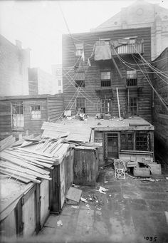 Tenement Backyard with many wires and outhouses