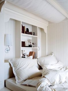 I like what they did with the space behind the bed......no need for a headboard.   cozy bedroom nook