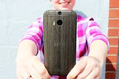 Sass up your HTC One with a sleek and sensuously curved real wood cover that's one in a million.  Beautifully engineered with precise details, laser-cut & hand-finished.  Simple peel & stick application.