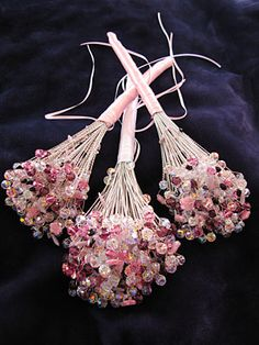 this was my inspiration for the bouquets I made for my wedding. Beads were on sale @ micheals or hobby lobby, and i used coupons. i also bought some off e-bay, got a good deal on a pound of wire. theres a how to link somewhere. these last forever and make a wonderful keepsake. all my sisters and my matron of honor have theirs displayed in their homes. mine sits on my mantle :)
