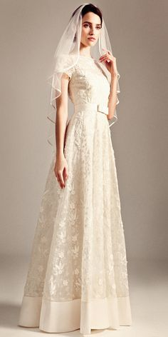 Temperly Bridal from Fall 2014. Nothing like a perfect A-line dress. Classic and chic.
