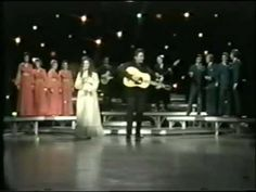 "From the March 16, 1971 episode of The Johnny Cash Show, Johnny and June are joined by the Carter Family, the Statler Brothers, Carl Perkins and the Tennessee Three for a jouful version of the old-time gospel number ""I'll Fly Away."""