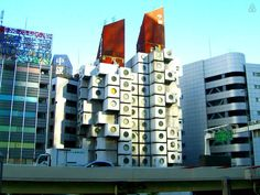 Capsule Tower are made of two towers(Left:B tower.Right:A Tower) - Get $25 credit with Airbnb if you sign up with this link http://www.airbnb.com/c/groberts22