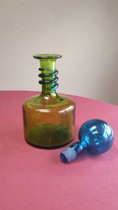 Blenko?  No, this is believed to be Rainbow glass.  Green decanter, applied blue swirl and round blue stopper.